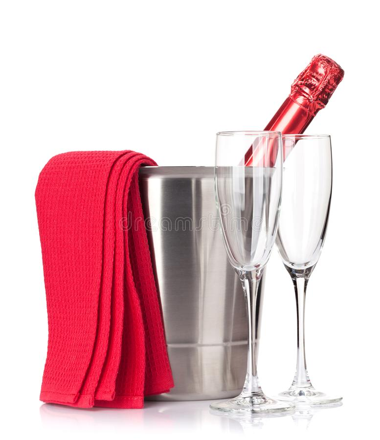 Champagne bottle in ice bucket and glasses stock photo
