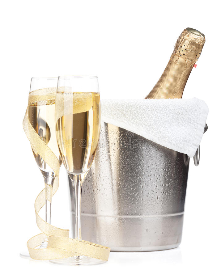 Champagne bottle in ice bucket, two glasses and christmas decor stock photos