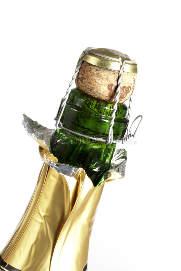 Champagne bottle neck and cork. Isolated on a white background royalty free stock photography