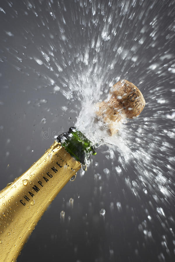 Champagne bottle popping cork close-up stock photos