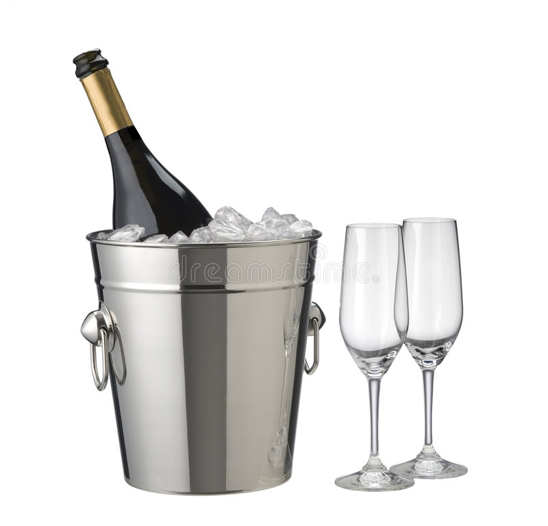 Champagne bucket. With ice, open bottle and glasses on white royalty free stock image