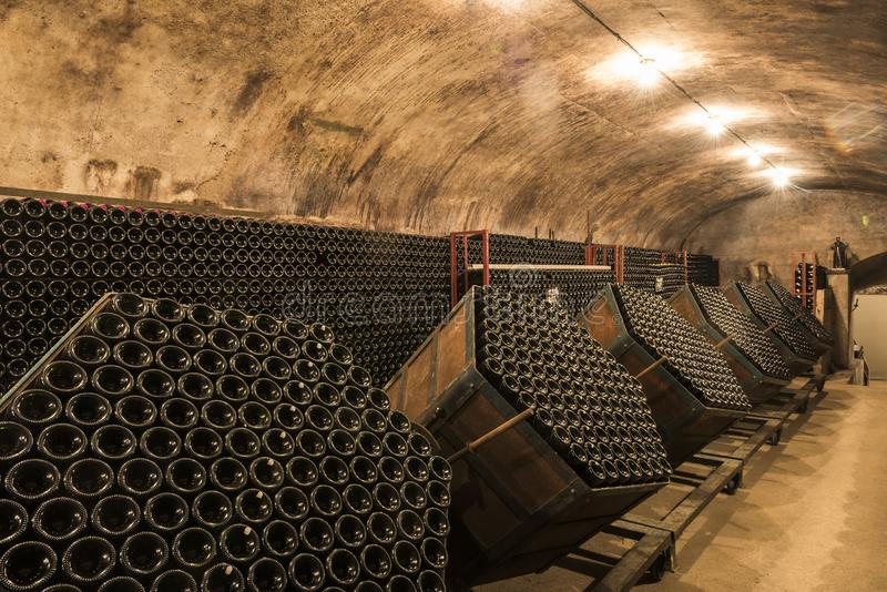 Champagne Caves Gyropalettes in Hautvillers. Hautvillers, France - August 11, 2017: Champagne caves and cellars with champagne bottles in gyropalettes for royalty free stock photos