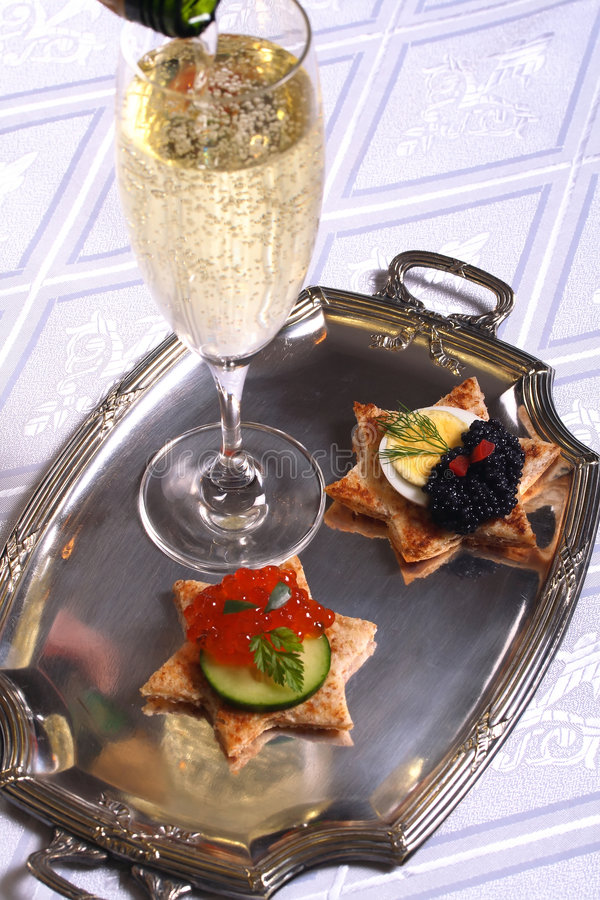 Champagne and caviar canape royalty free stock photo