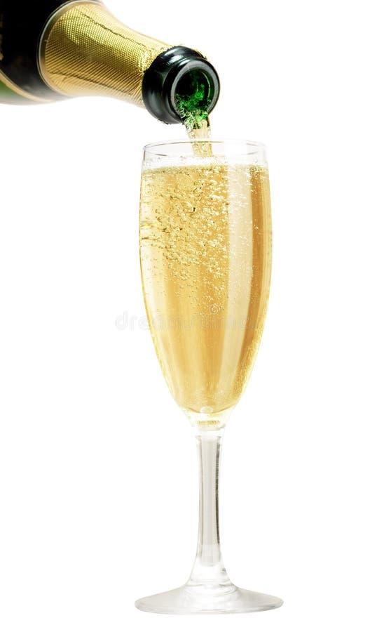 Champagne che versa in vetro fotografia stock