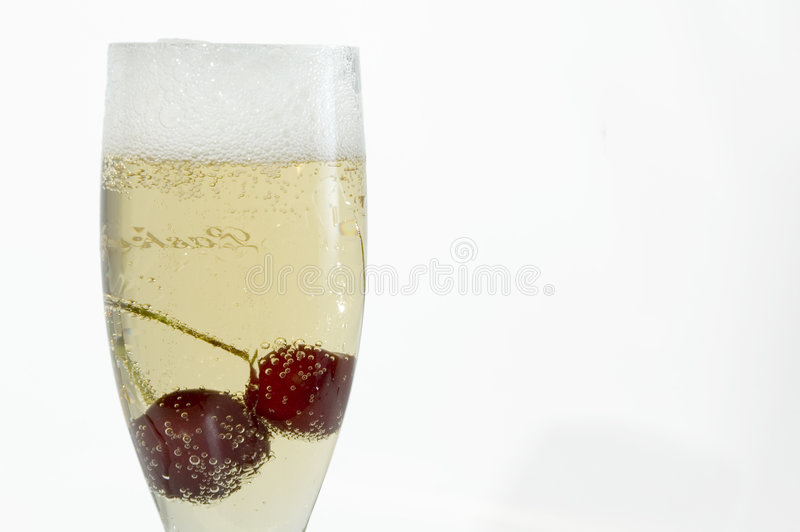 Champagne with cherry stock images