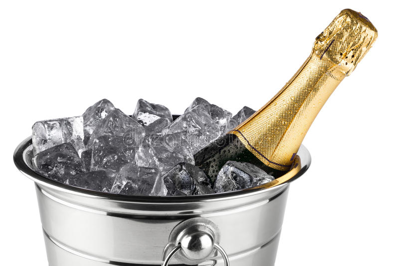 Champagne cooler. Bottle of champagne in cooler with ice cubes royalty free stock image