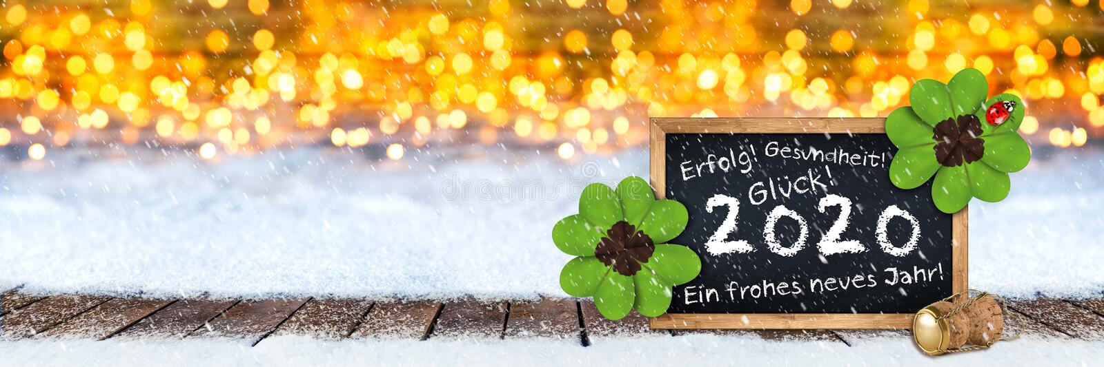 Champagne cork and blackboard with german greeting frohes neues jahr 2020 traduction anglaise: joyeux nouvel an 2020 en bois photos stock