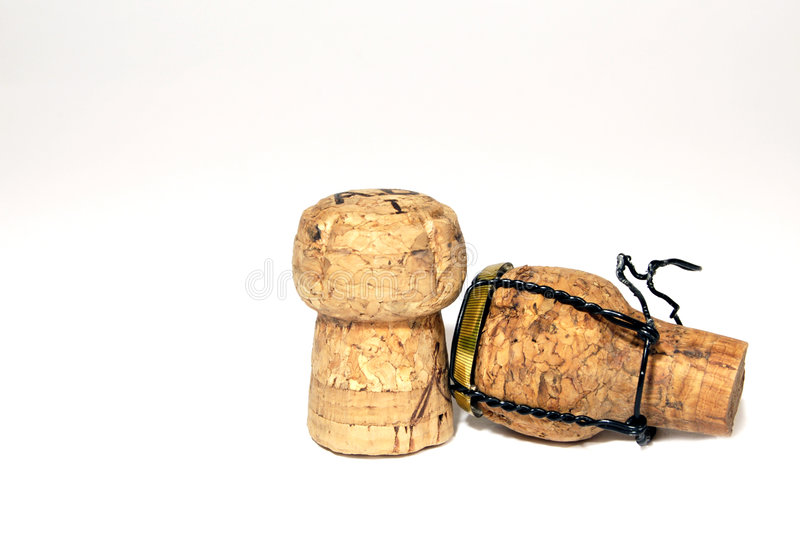 Champagne corks. Two champagne corks on a white background stock image