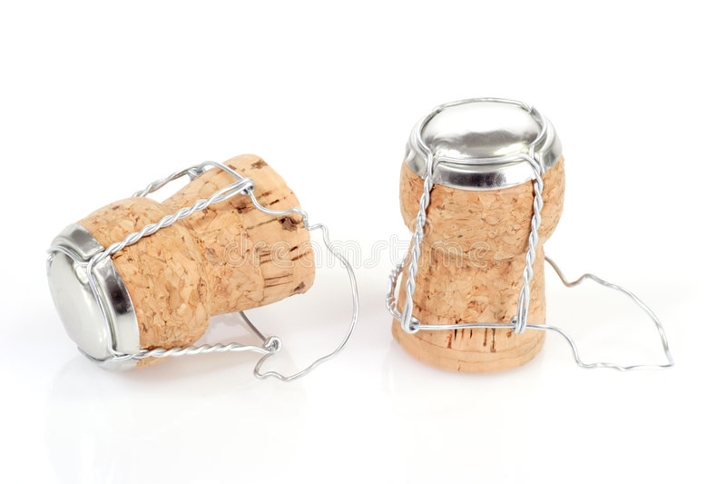Champagne Corks. Two champagne corks - isolated on white background royalty free stock images