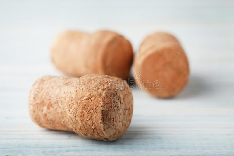 Champagne corks. On blue wooden table royalty free stock images