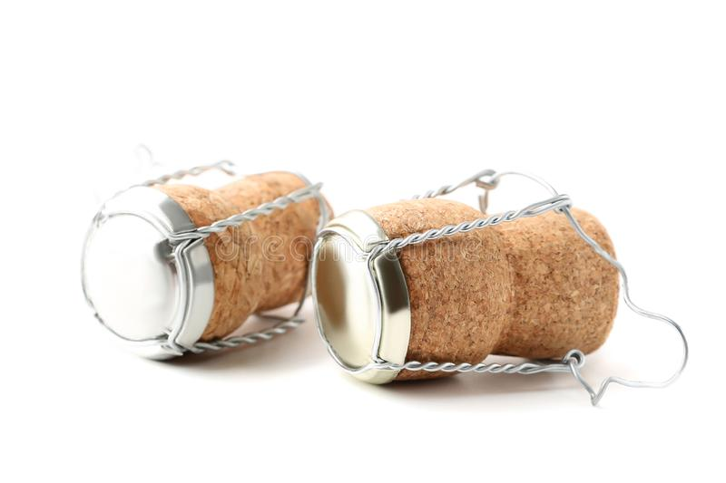 Champagne corks with caps. Isolated on white background royalty free stock photography