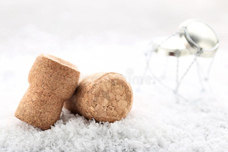 Champagne corks. With caps on white snow stock photos