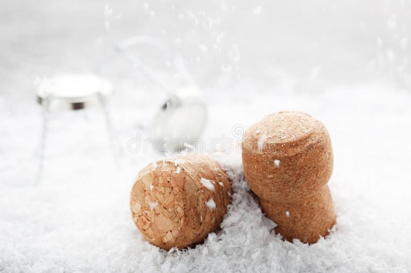 Champagne corks. With caps on white snow royalty free stock photography