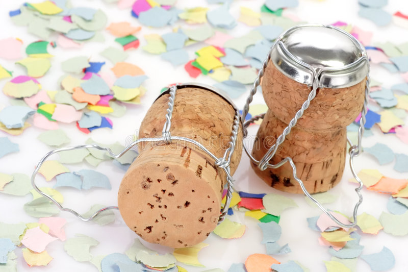 Champagne Corks with Confetti. Two champagne corks and confetti on white background stock photography