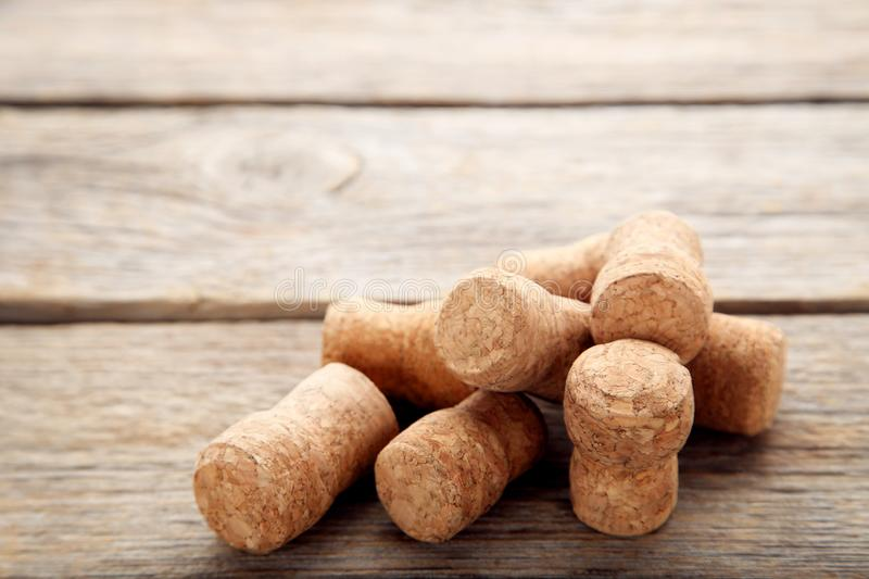 Champagne corks. On grey wooden table stock photography