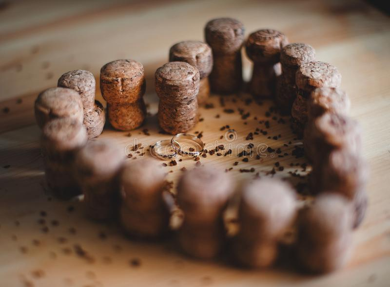 Champagne corks were put in the shape of a heart. Wedding rings lie inside stock photography