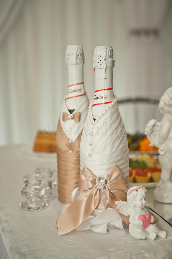 Champagne dressed as bride and groom 1606. stock images