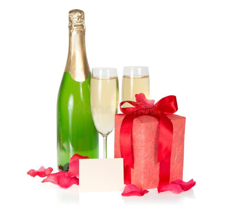 Champagne et cadre de cadeau image stock
