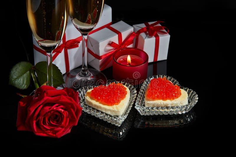 Champagne et caviar rouge photo stock