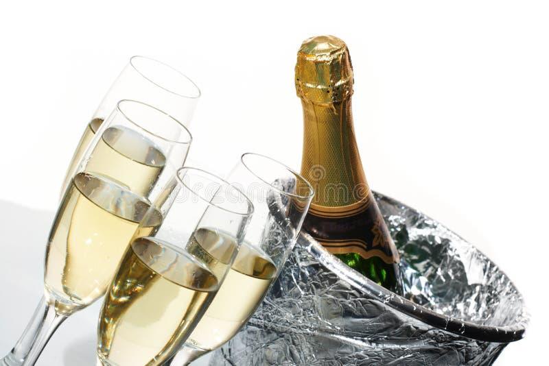 Champagne et seau à glace image libre de droits