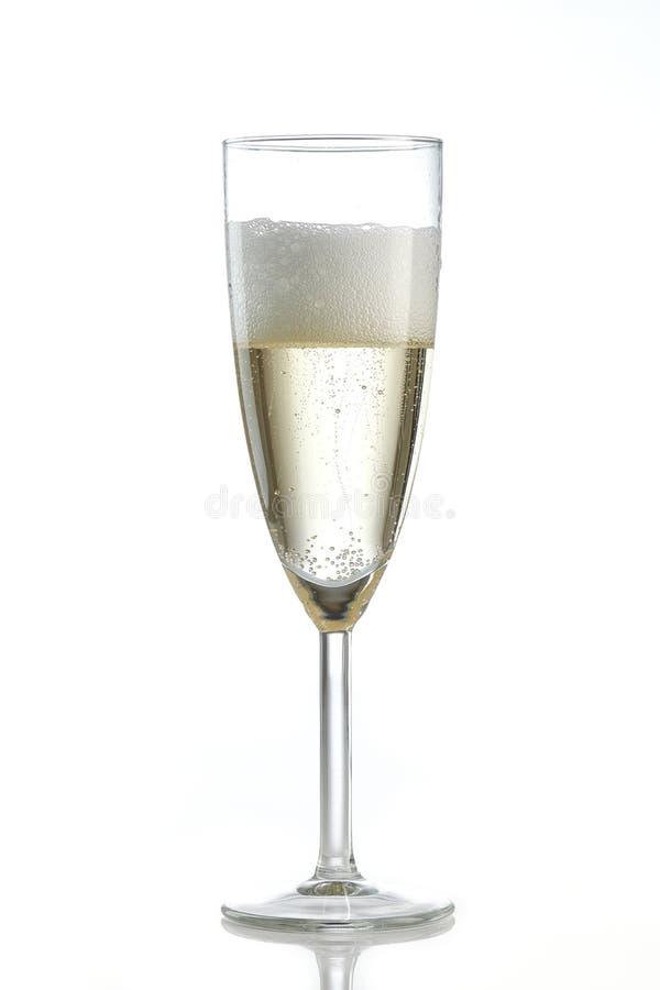 Champagne Flute freddo ghiacciato con le bolle fotografie stock libere da diritti