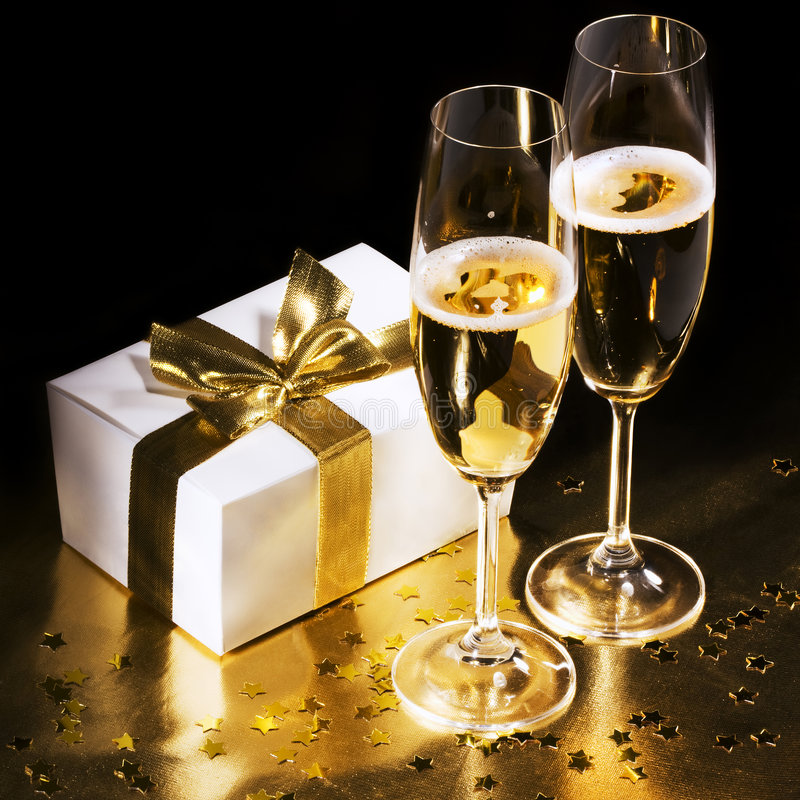 Champagne flutes with gift stock photography
