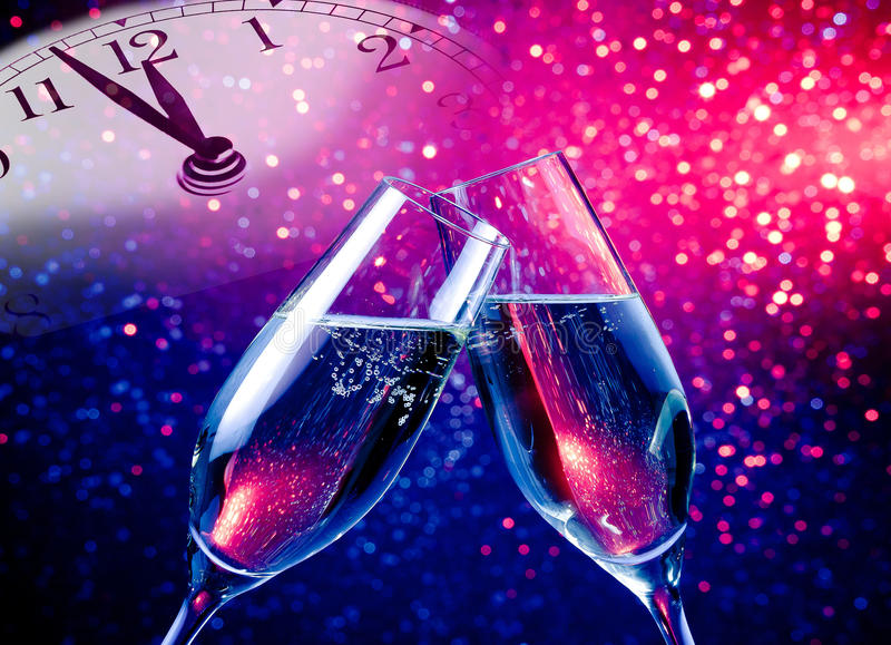 Champagne flutes with golden bubbles on blue and purple violet light bokeh background. Champagne flutes with golden bubbles make cheers on blue and purple violet stock photos