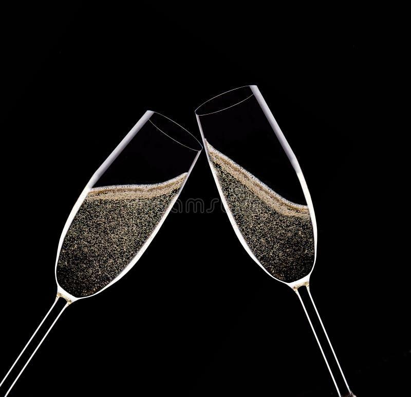 Champagne Flutes på svart bakgrund royaltyfri foto