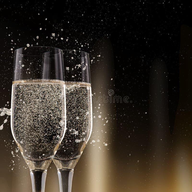 Champagne Flutes su fondo nero fotografia stock