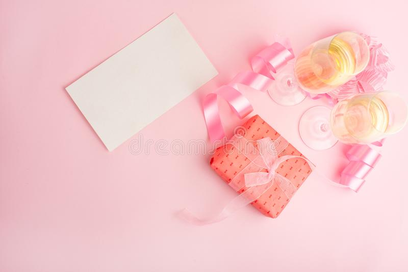 Champagne, gift, bow. Invitation, birthday, party on the occasion of girlhood, the concept of a baby shower, a holiday on a pink b stock photo