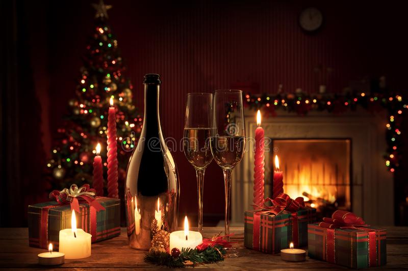 Champagne with gifts on  color back royalty free stock image