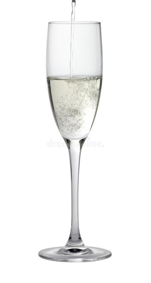 Champagne-Glas beim Füllen lizenzfreie stockfotos
