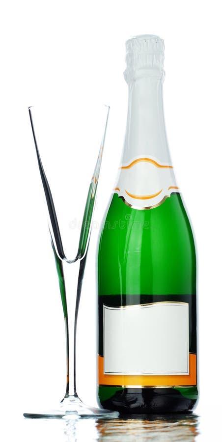 Champagne-Glas und Flasche stockfotos