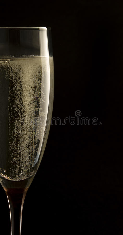 Champagne in glass on black background stock photo