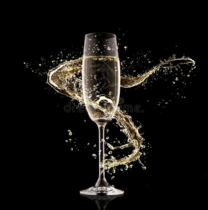 Champagne glass with splash. Celebration theme. Glass of champagne with splash, isolated on black background stock photo