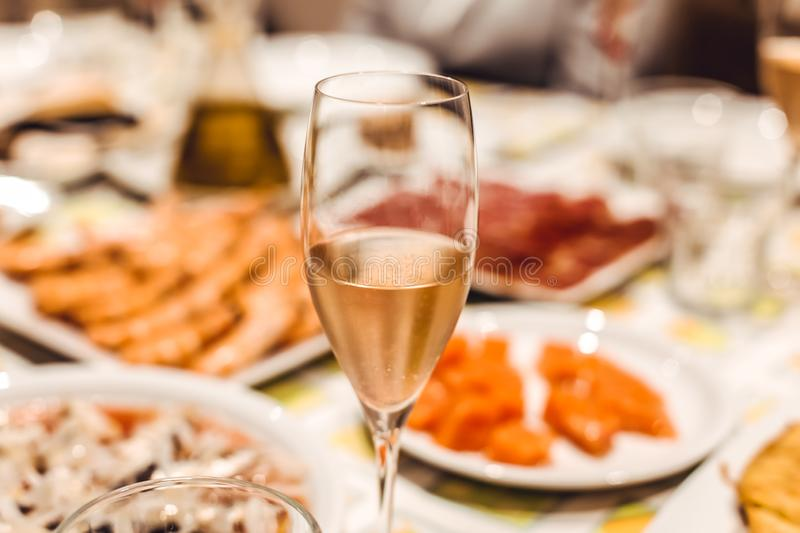Champagne glass on table stock photography