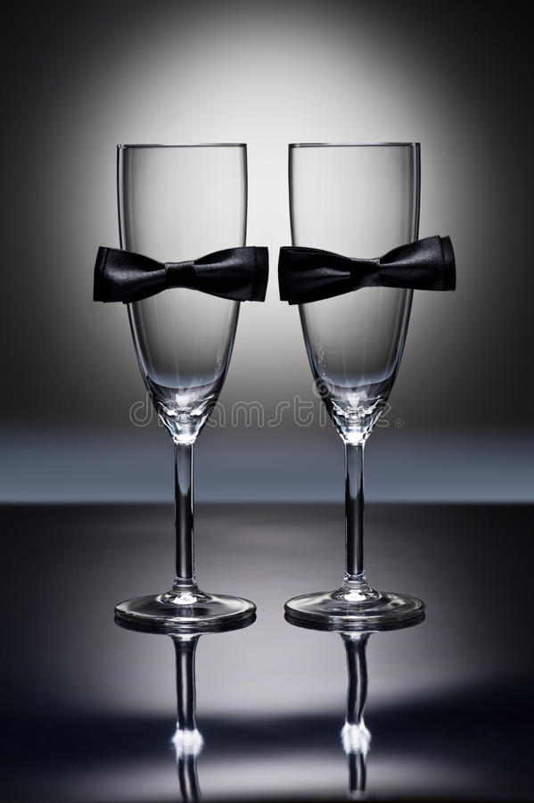 Champagne glasses. With conceptual same sex decoration for gay men stock photo
