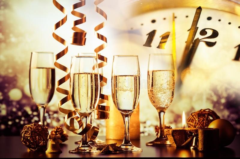 champagne glasses against holiday lights ready for New Year& x27;s eve party stock photos