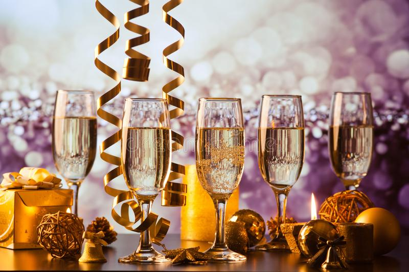 champagne glasses against holiday lights ready for New Year& x27;s eve party stock images