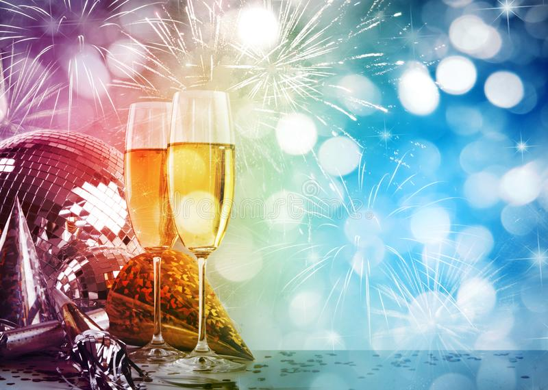 Champagne glasses against New Years background stock image