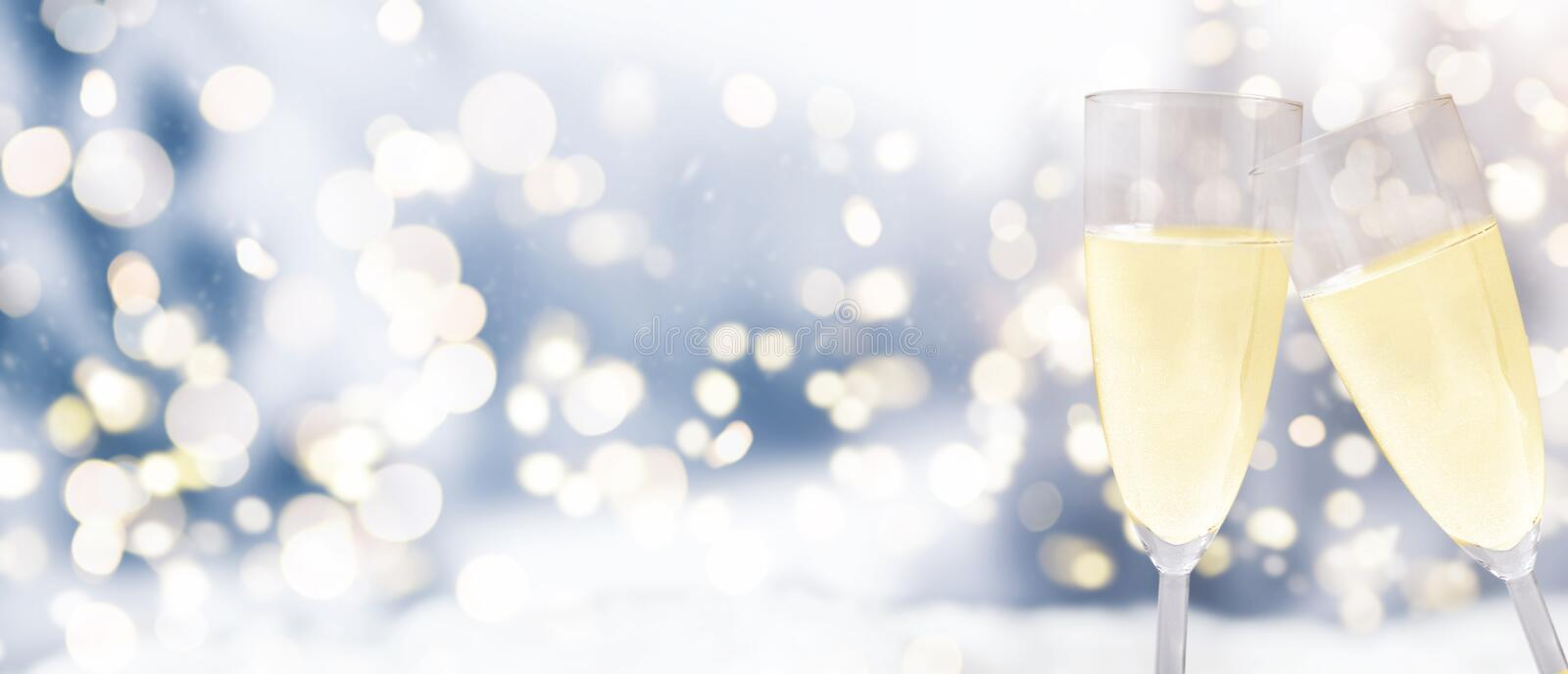 Champagne glasses against winter background royalty free stock photography