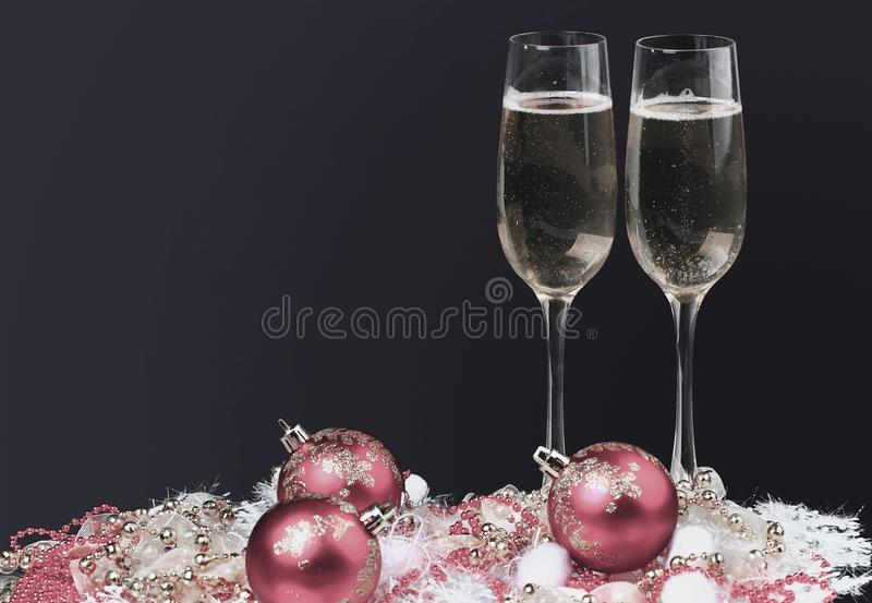 Champagne glasses on celebration table. black background royalty free stock photo