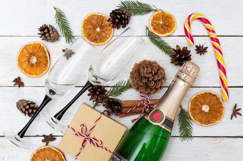 Champagne with glasses and Christmas decorations on a wooden background. Flat lay stock images