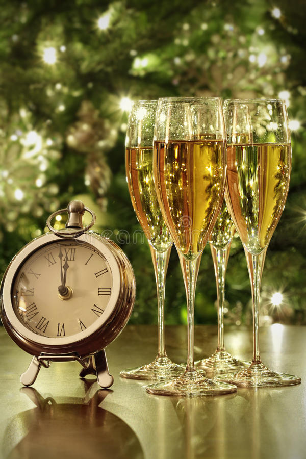 Champagne glasses, clock with lights royalty free stock image