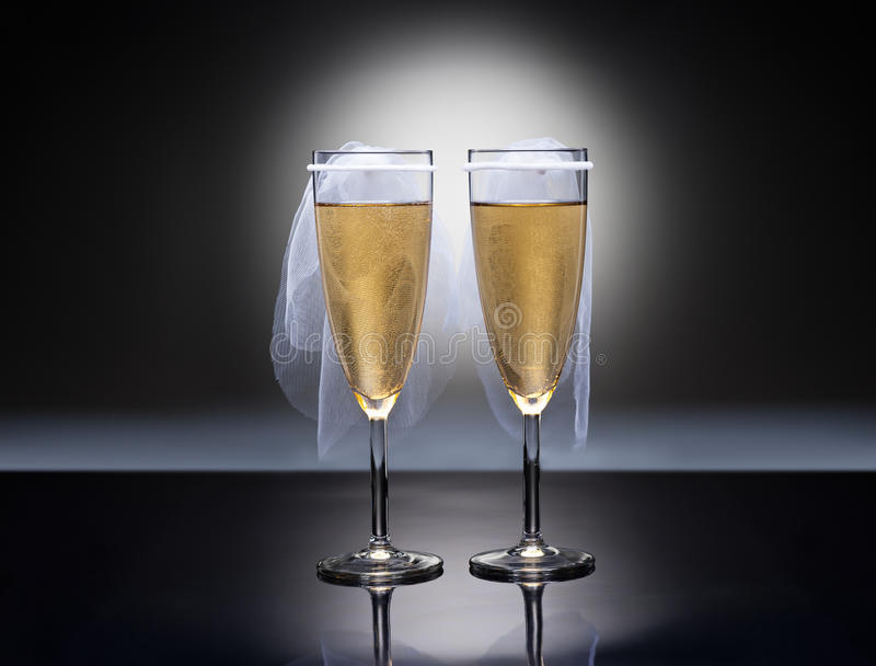 Champagne glasses with conceptual same sex decoration. Lesbian stock photo
