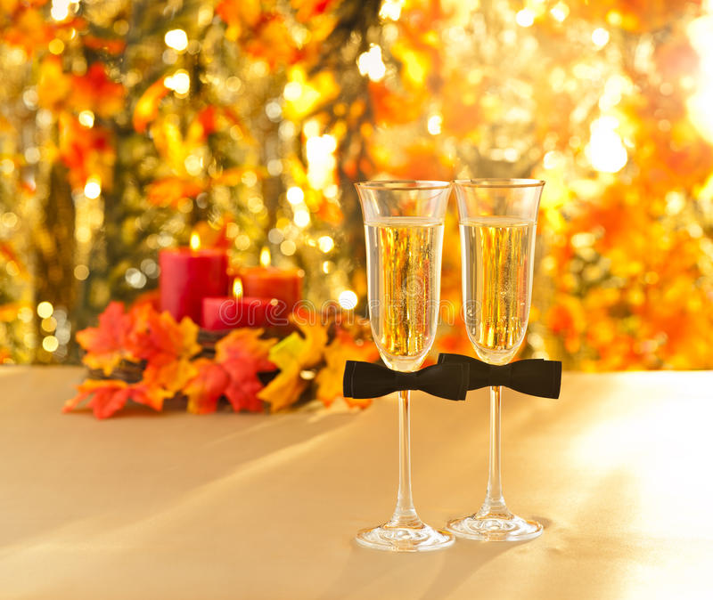 Champagne glasses with conceptual same sex decoration for gay. Men in front of autumn deco royalty free stock photos