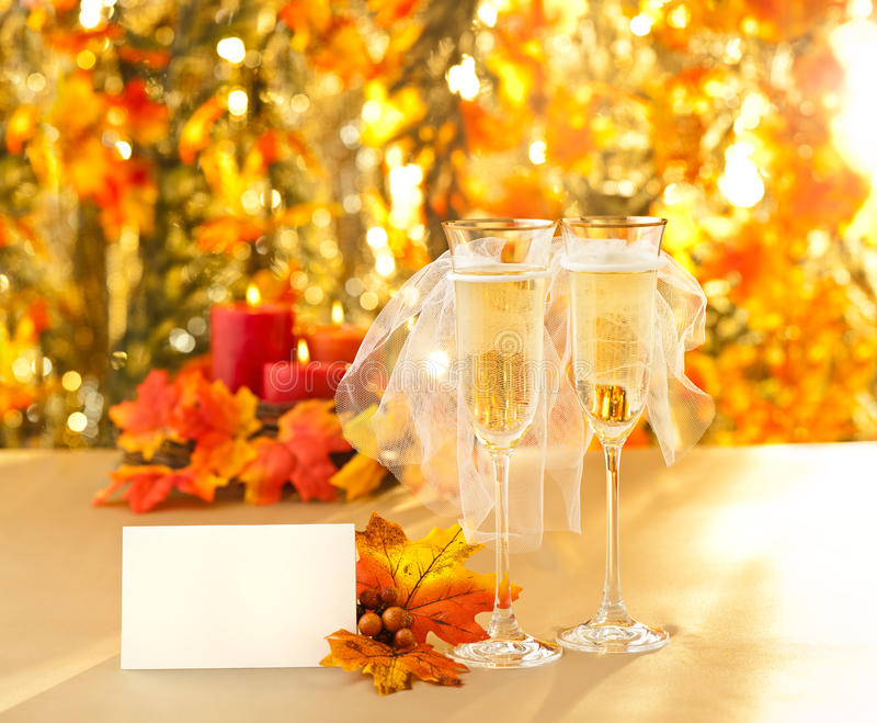 Champagne glasses with conceptual same sex decoration. Lesbian with place card stock image