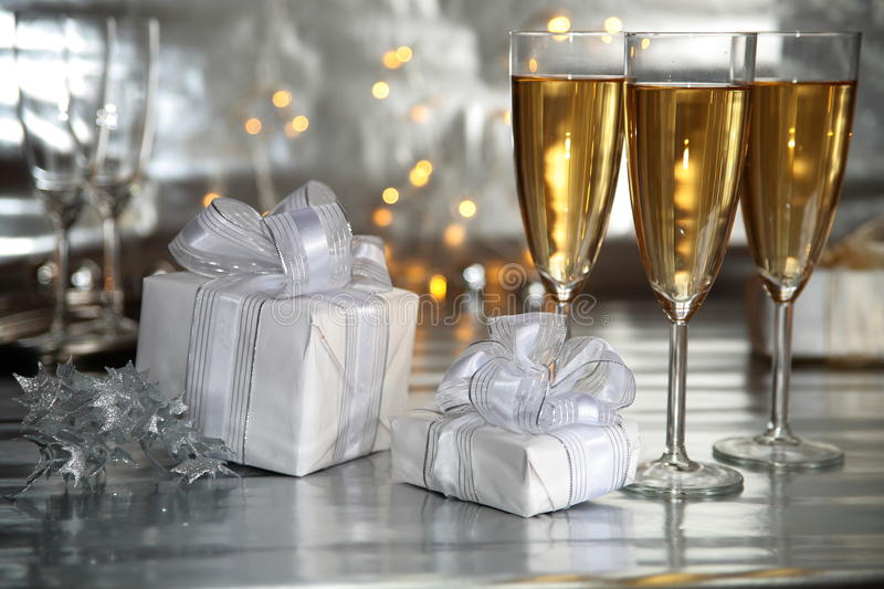 Champagne in glasses and gifts royalty free stock images