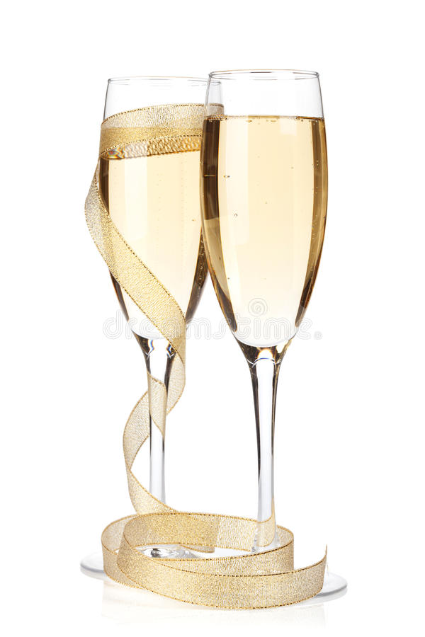 Champagne glasses with golden ribbon stock photo