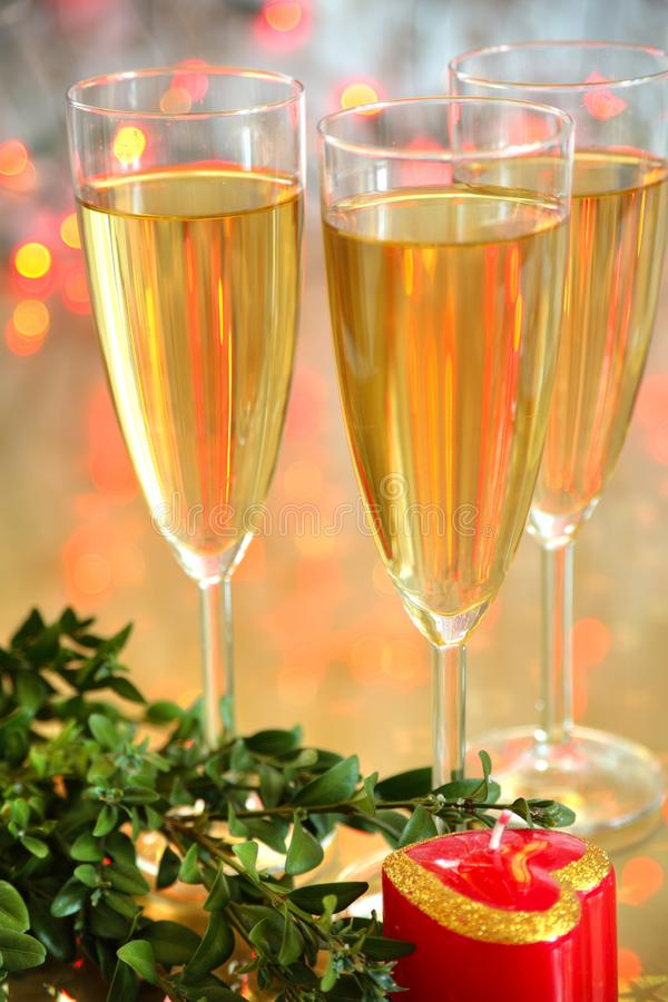 Champagne in glasses and green twig